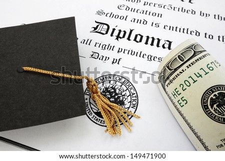 graduation cap and money on a diploma                                - stock photo