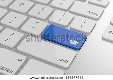 Graduation cap button on keyboard with soft focus
