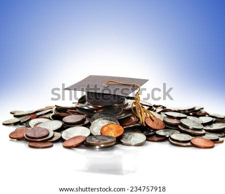 graduation cap  on a pile of money ( student debt ) - stock photo