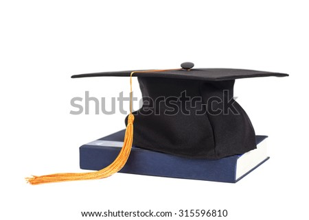 Graduation Cap On  Book isolated - stock photo