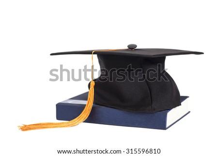 Graduation Cap On  Book isolated - stock photo