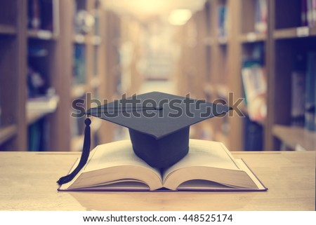 graduation cap over open Books on Library room,Education concept - stock photo