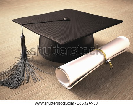 graduation cap with diploma over the table clipping path included