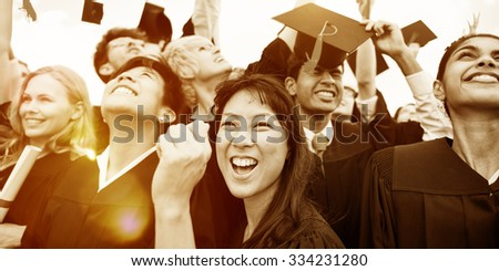 Graduation Caps Thrown in the Air Celebration Concept - stock photo