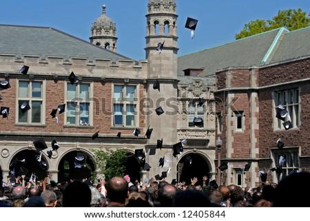 graduation celebration, throwing caps - stock photo