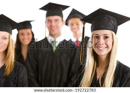 Graduation: Focus On Pretty Female Graduate With Others Behind