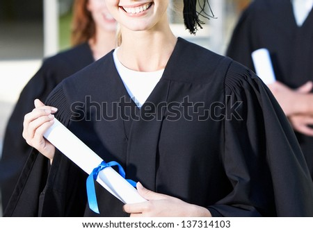 graduation girl holding her diploma