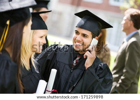 Graduation: Happy Hispanic Student Calling Friends After Graduation