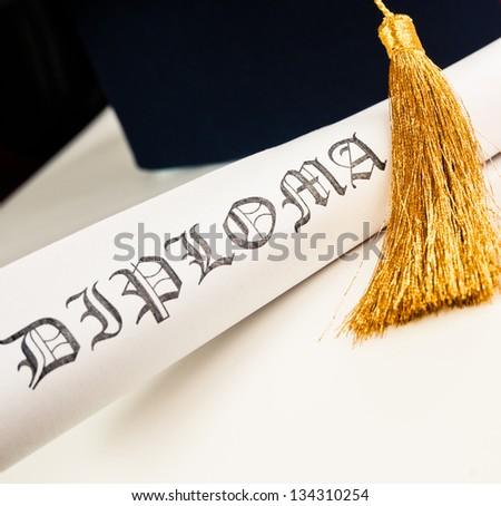 Graduation hat and Diploma - stock photo