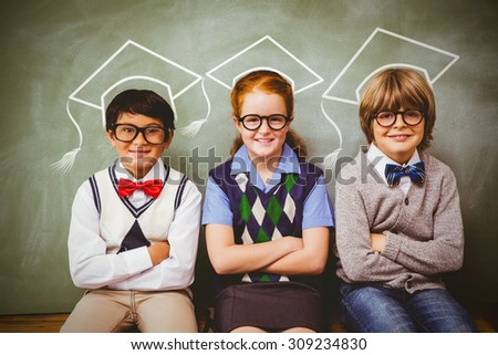 Graduation hat vector against smiling little school kids in classroom - stock photo