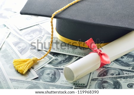 Graduation hat with diploma and money - stock photo