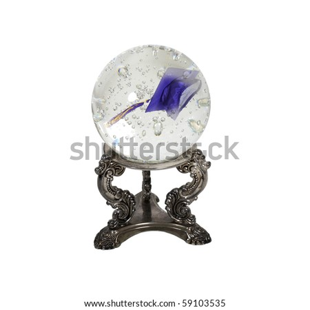 Graduation in the future shown by a graduation mortar in a crystal ball  - path included - stock photo