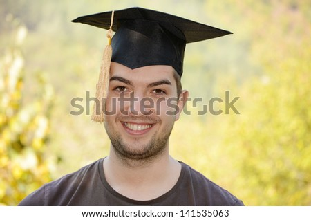 graduation man portrait smiling and looking hap