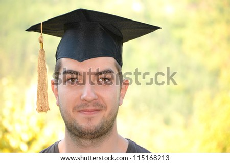 graduation man  portrait smiling and looking happy