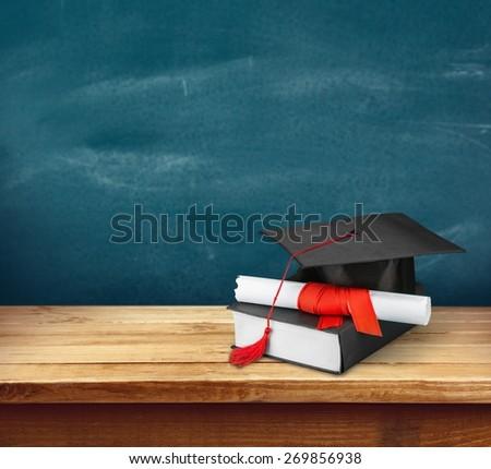 Graduation, Mortar Board, Diploma. - stock photo