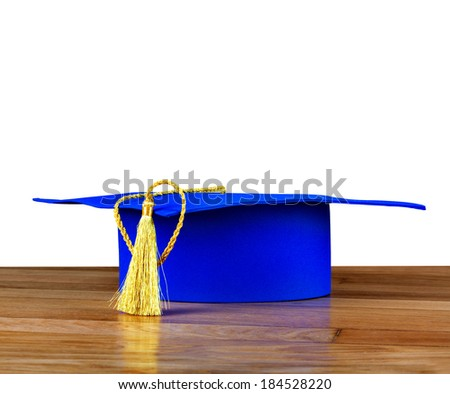 Graduation mortarboard on wooden table on the white isolated background  - stock photo
