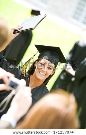 Graduation: Parents Take Photo Of Graduate - stock photo