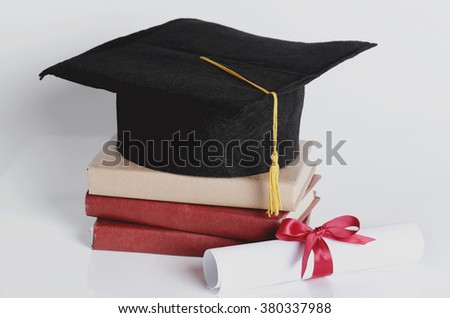 Graduation. Square academic hat with books - stock photo