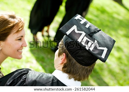 Graduation: Student With Funny Statement on Hat For Mom - stock photo