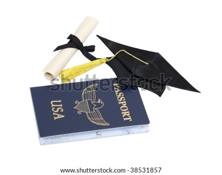 Graduation travels shown by a passport, graduation document and mortar board - path included - stock photo