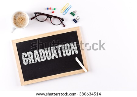 GRADUATION word on Chalkboard with Coffee Cup, view from above - stock photo