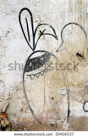 Graffiti cartoon with text balloon painted on a grunge wall in Havana, Cuba - stock photo