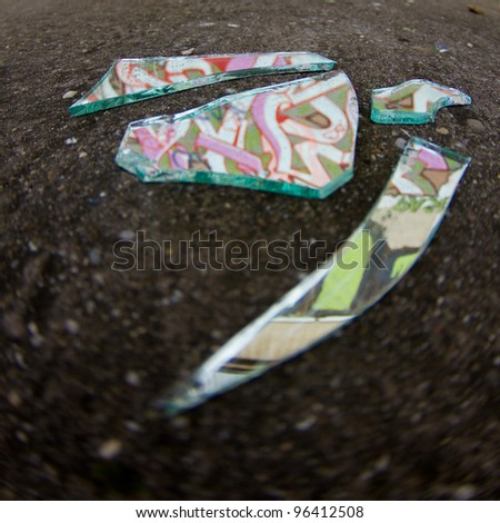 graffiti in pieces of broken mirror - stock photo