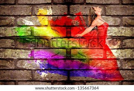 Graffiti of a woman in colorful dress on a brick wall - stock photo