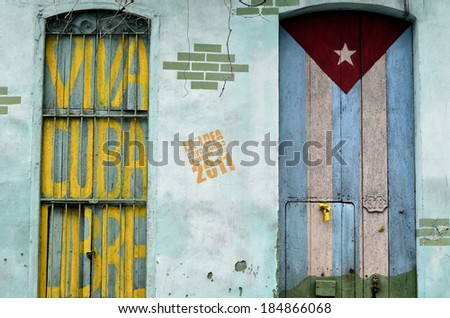 "Graffiti of Cuban Flag and slogan ""Viva Cuba Libre"" on the wall - stock photo"