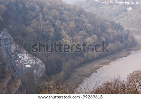 Graffiti on a rock face in the Avon Gorge on the outskirts of Bristol UK proclaiming the city's radicalism - stock photo
