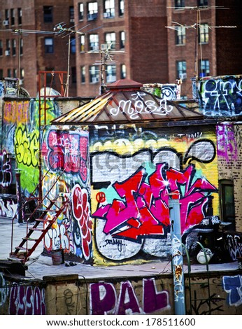 Graffiti on apartment buildings in New York  - stock photo