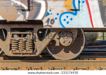 Graffiti on Container Loaded onto Tracks - stock photo