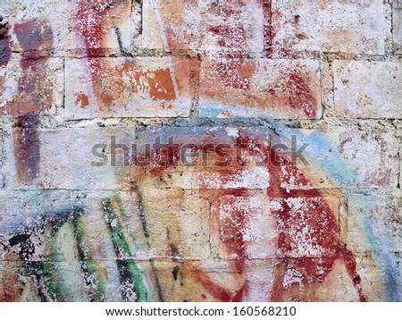 Graffiti on old brick wall. - stock photo