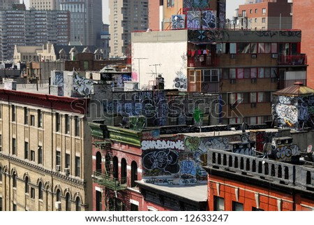 Graffiti on the top of buildings in New York City - stock photo