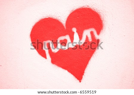 Graffiti Pain in love heart stencil. Similar to Banksy work - stock photo