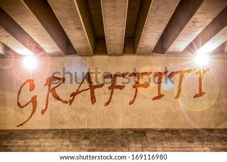 Graffiti painted as graffiti on the support column of an overpass - stock photo