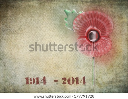 Graffiti style remembrance day poppy on grunge background. Dates on 1914-2014 in stencil style to commemorate the Centenary of World War One. - stock photo