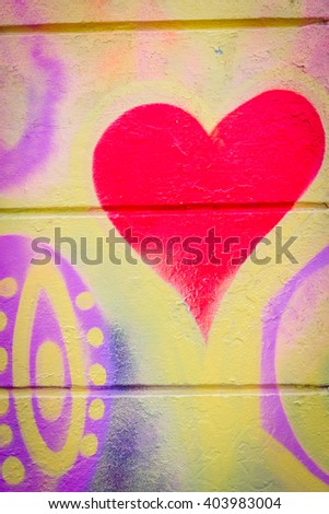 Grafitti with a heart on a concrete wall in hippie style - stock photo
