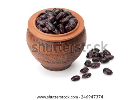 Grain beans in ceramic pot isolated on white background - stock photo