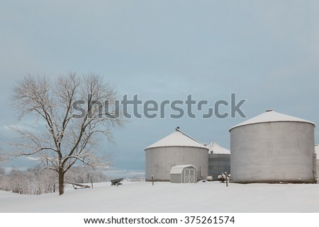 Grain bins after a winter storm