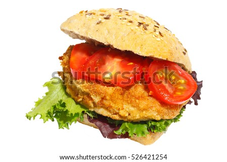 Grain bun with fried pork, lettuce and tomatoes, isolated