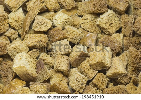 Grain crackers, background. Slices of the bread which has been dried up in an oven. Can be used as ingredient for other dishes, and when crushing as breadcrumbs. - stock photo