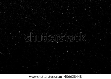 grain dust scratches on black background - stock photo