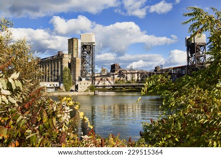 Grain elevator along the Buffalo, New York waterfront. The building, which was at one time the largest grain elevator in the world, is shot so it is framed by autumn-leaved trees. - stock photo