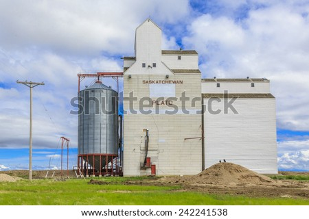 Grain elevator in the small Saskatchewan town of Plato on the Canadian prairies. - stock photo