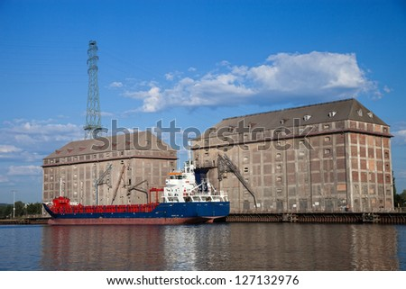 Grain elevator with terminal and ship in harbour Gdansk, Poland.