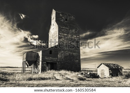 Grain elevators, which have been variously referred to as prairie icons, prairie cathedrals or prairie sentinels, are a visual symbol of western Canada. Processed with an infrared filter. - stock photo