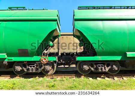 Grain hoppers on the railway track - cars coupling - stock photo