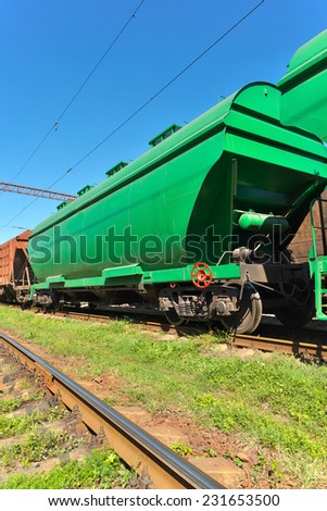 Grain hoppers on the railway track - vertical - stock photo