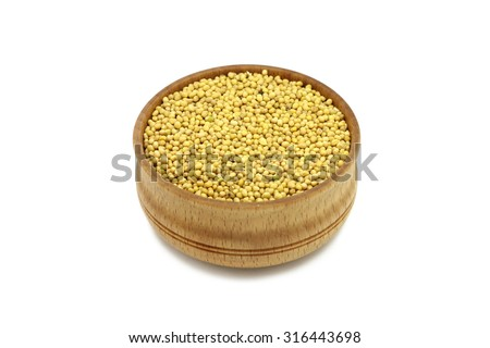 grain mustard in a wooden bowl on a white background